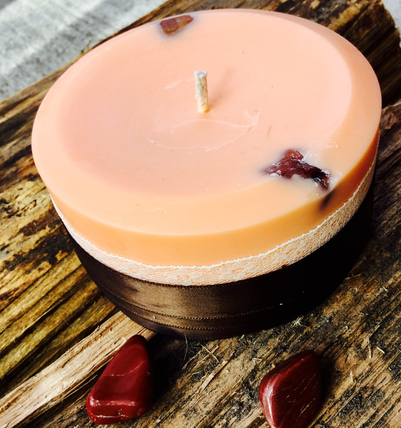 Sandalwood scented soy fertility candle embedded with Red Aventurine and wrapped with lace and ribbon.