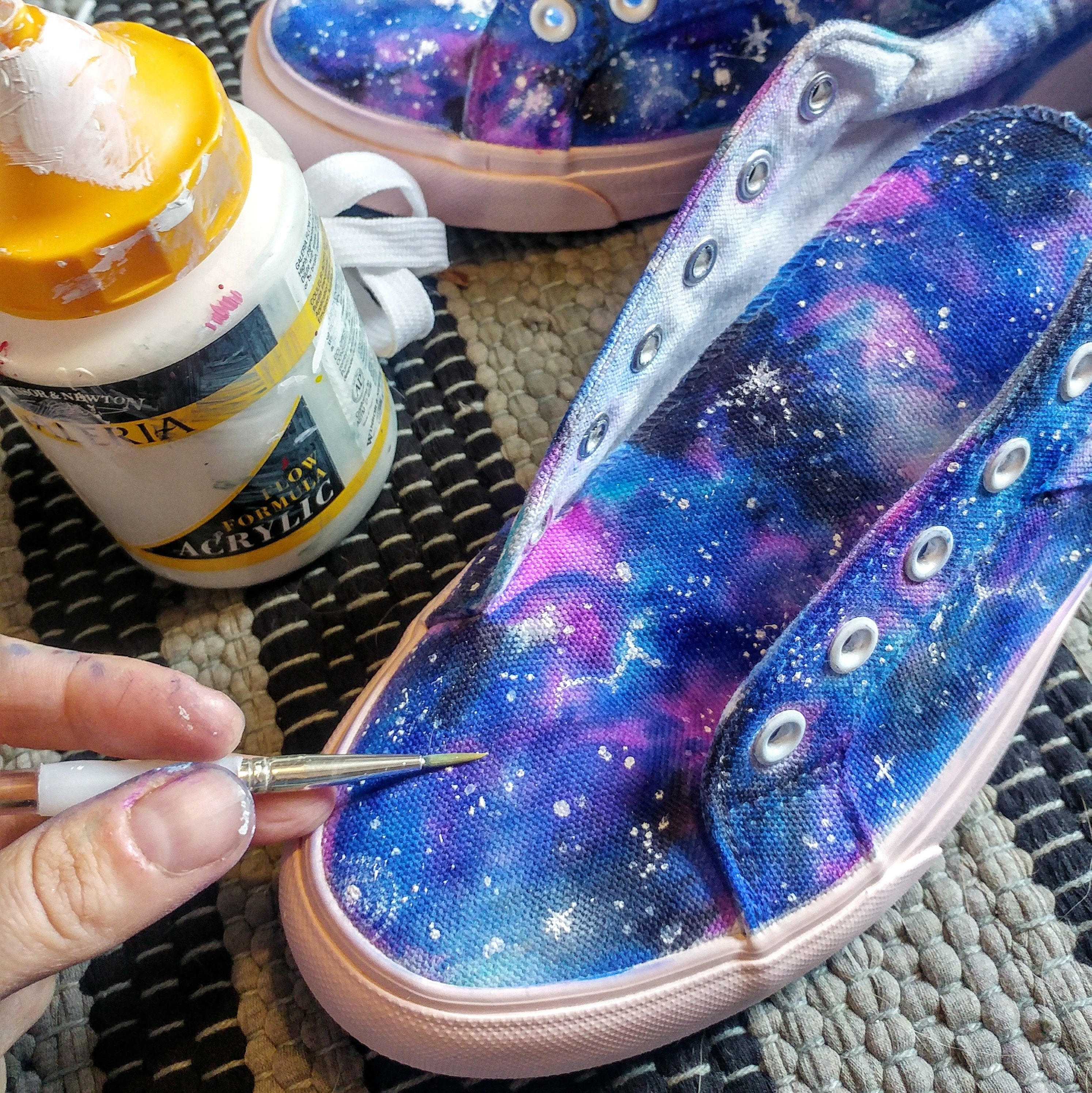 Painting stars with white acrylic
