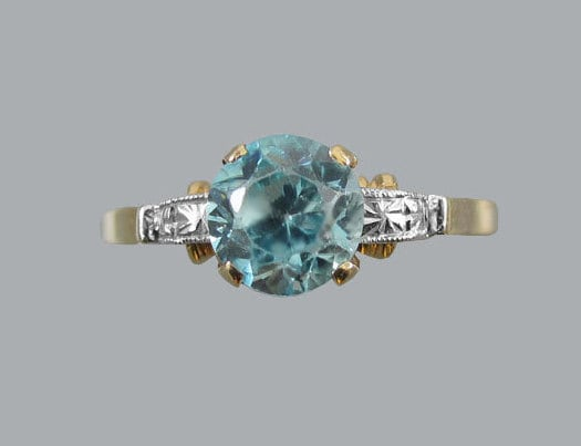 Signed Untermeyer Robbins antique Art Deco 14k gold and platinum natural blue zircon solitaire ring. Circa 1920-40.