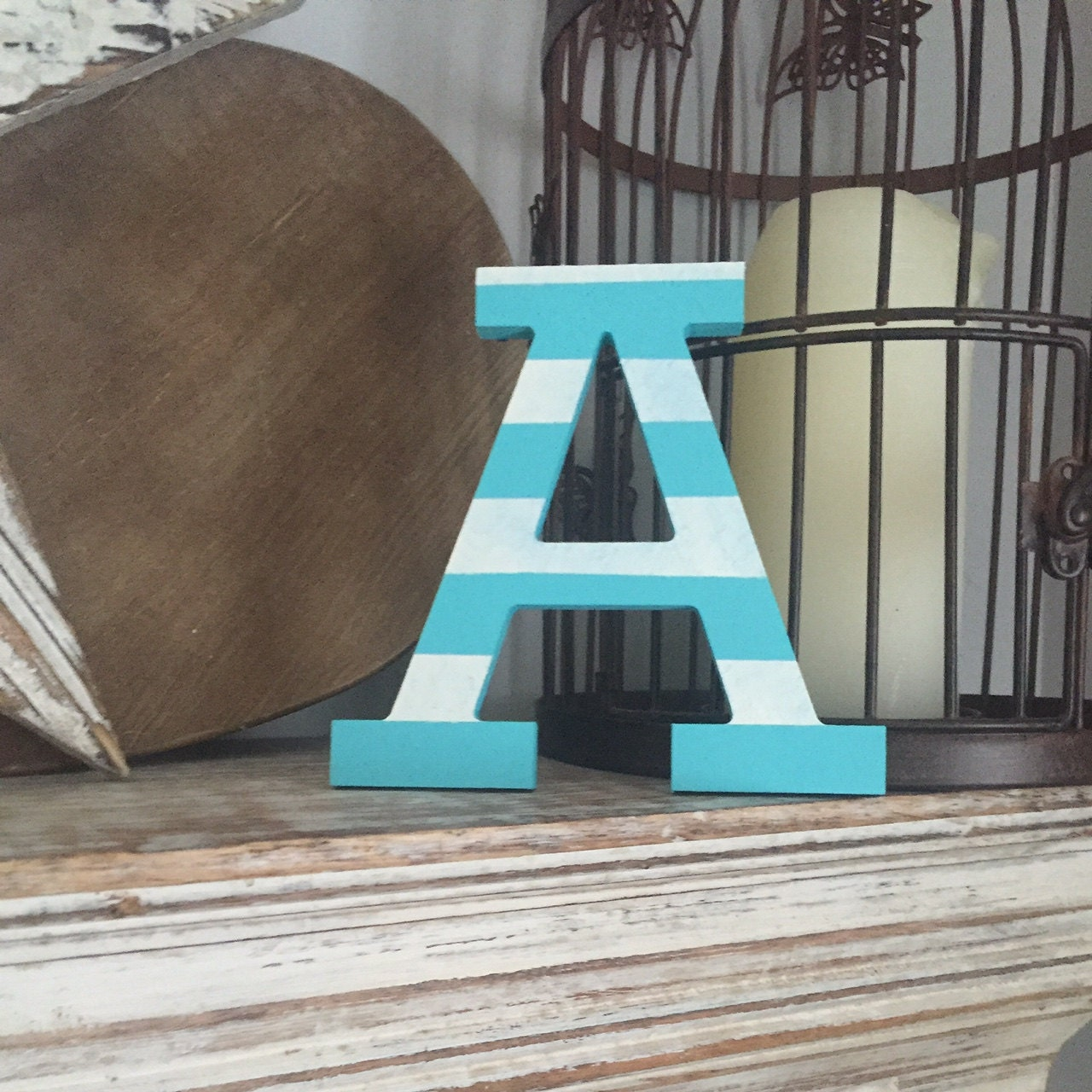 A, Rockwell font, striped finish
