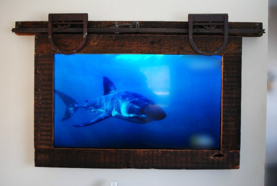 TV frame with reclaimed wood and antique barn door hardware