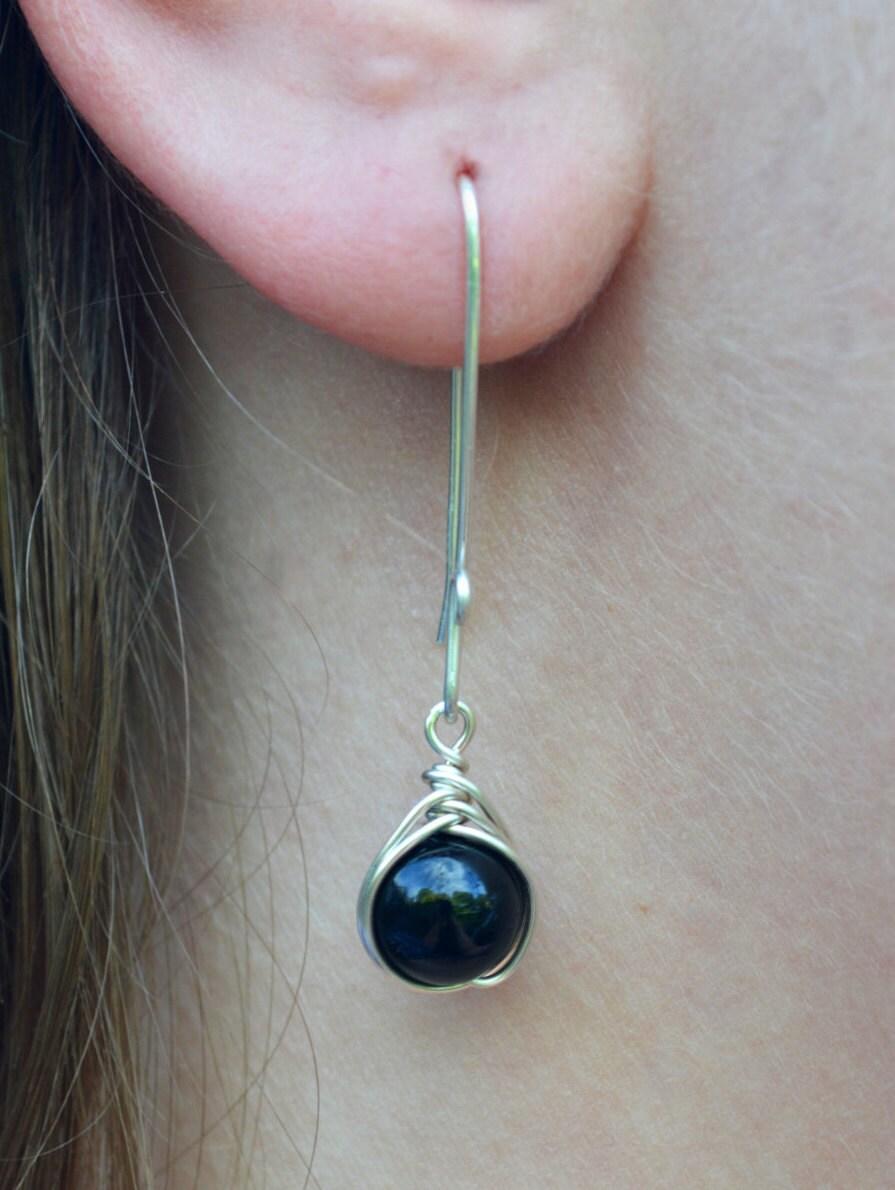 Ear wearing long drop earrings
