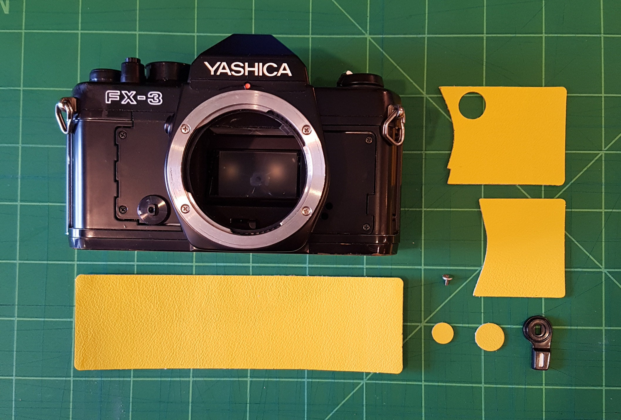 All the pieces laid out, ready to recover this awesome Yashica SLR