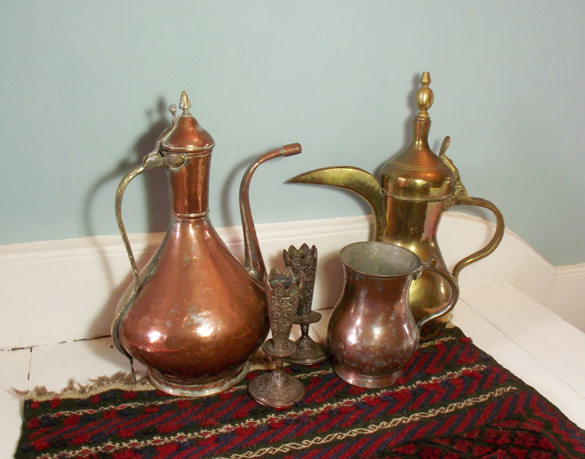 Collection of bohemian decor available in the Suki and Polly shop: an antique middle eastern copper coffee pot, an Arabic brass coffee pot, antique Kashmiri Vases and an antique copper tankard.
