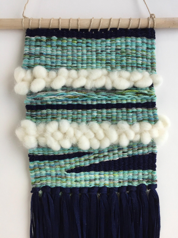 Woven Wall Hanging, with wool roving, merino wool and tencel yarn.