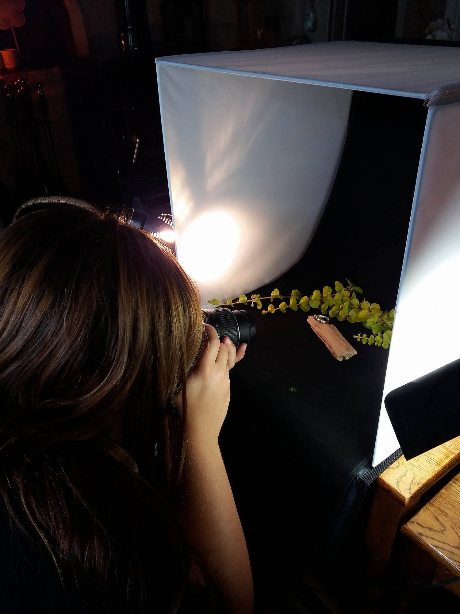Photography taking place in a small light box