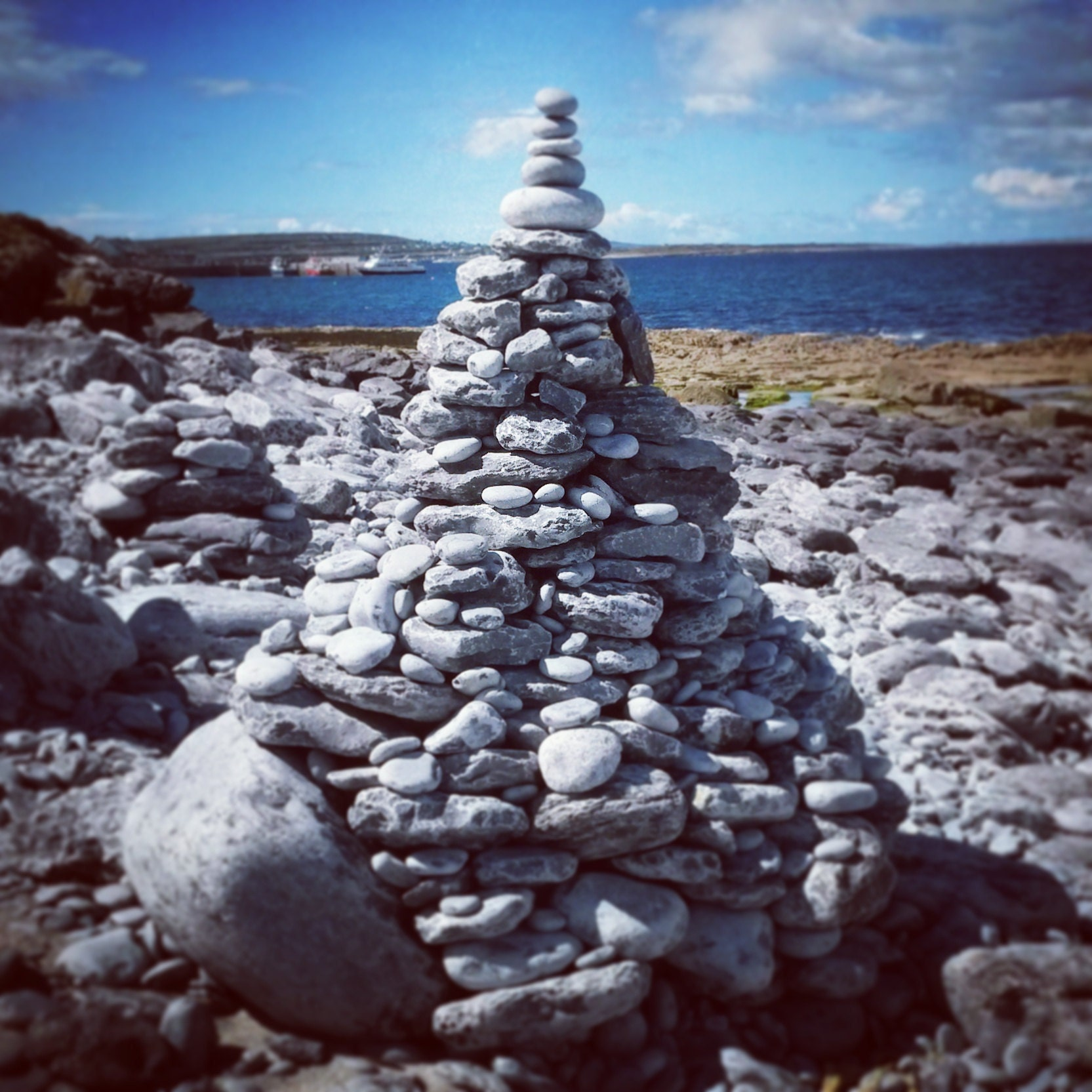 Stone cairn by the shore