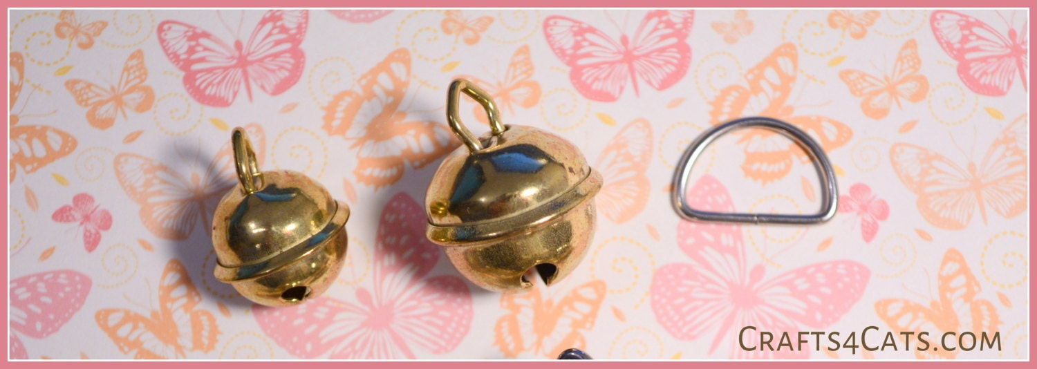 Cat collar bells and D-ring (also offered in our shop).