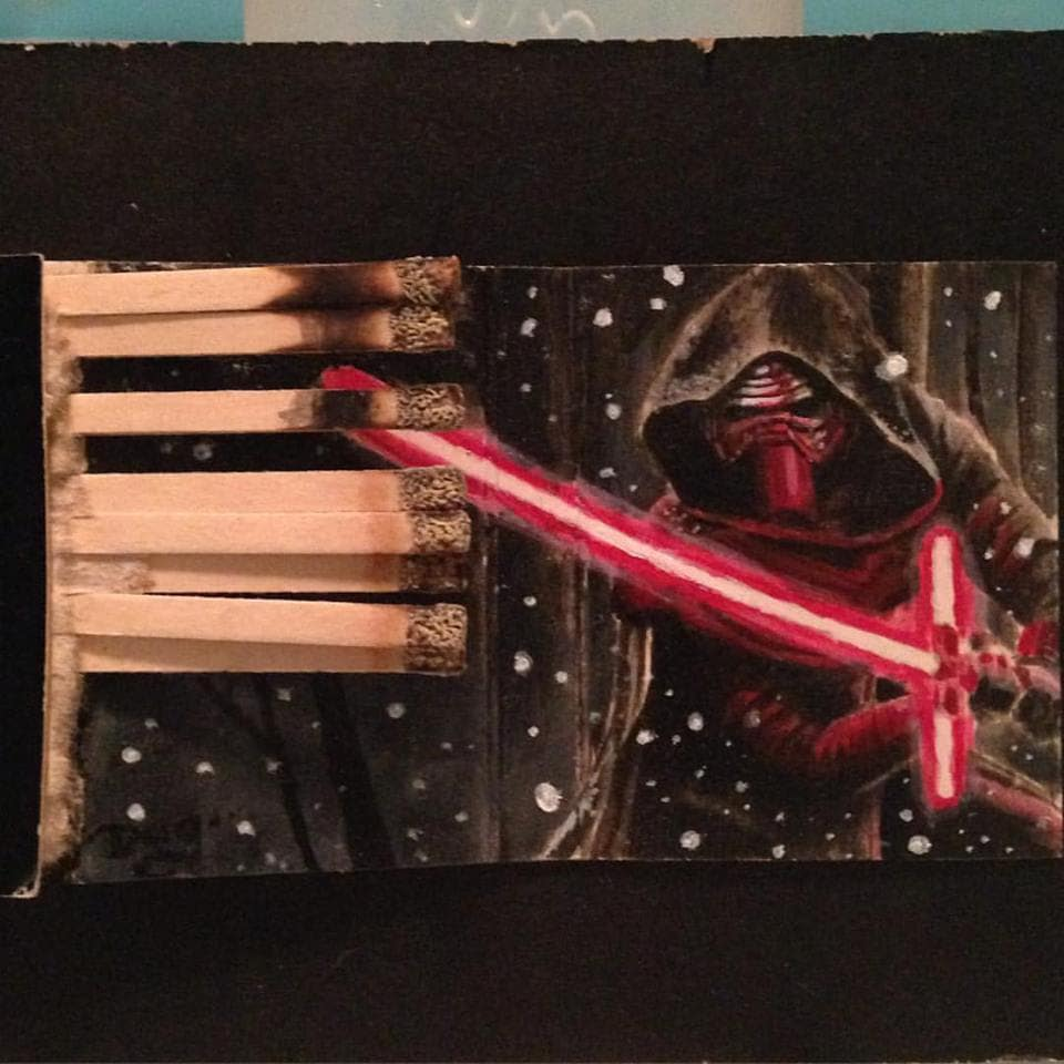 Kylo in the snow.  3.5x2 Acrylic on vintage matchbook