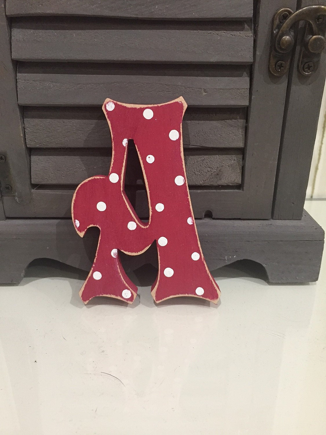 Letter A - Storybook Font - shown in red with white polka dots and a distressed finish