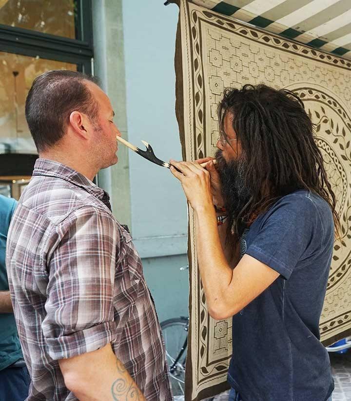 My friend Ryan receiving a rapé from a fellow shaman type medicine man at a market in Zürich.