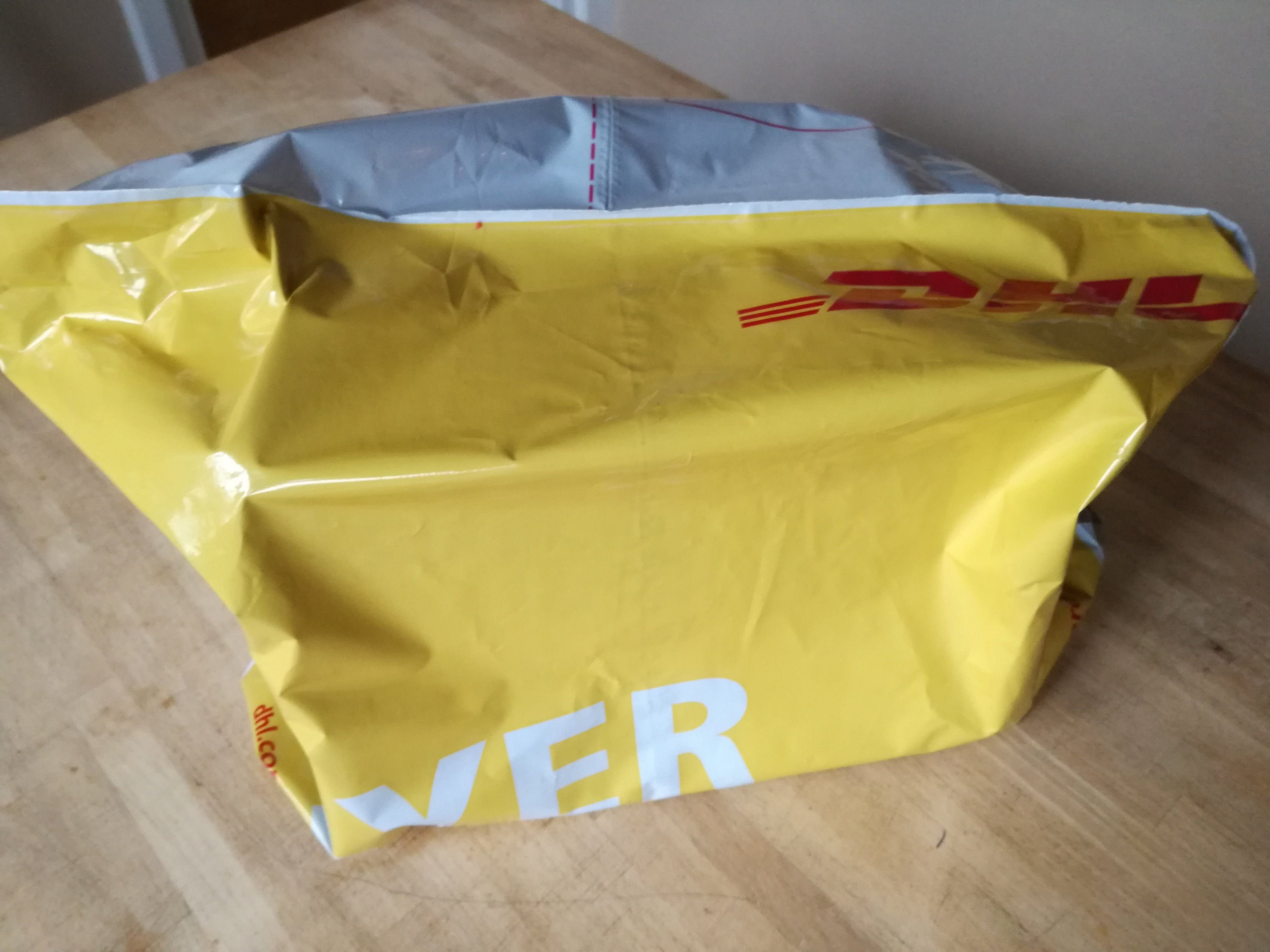 Small parcel covered by a DHL flyer - package is under 2kg